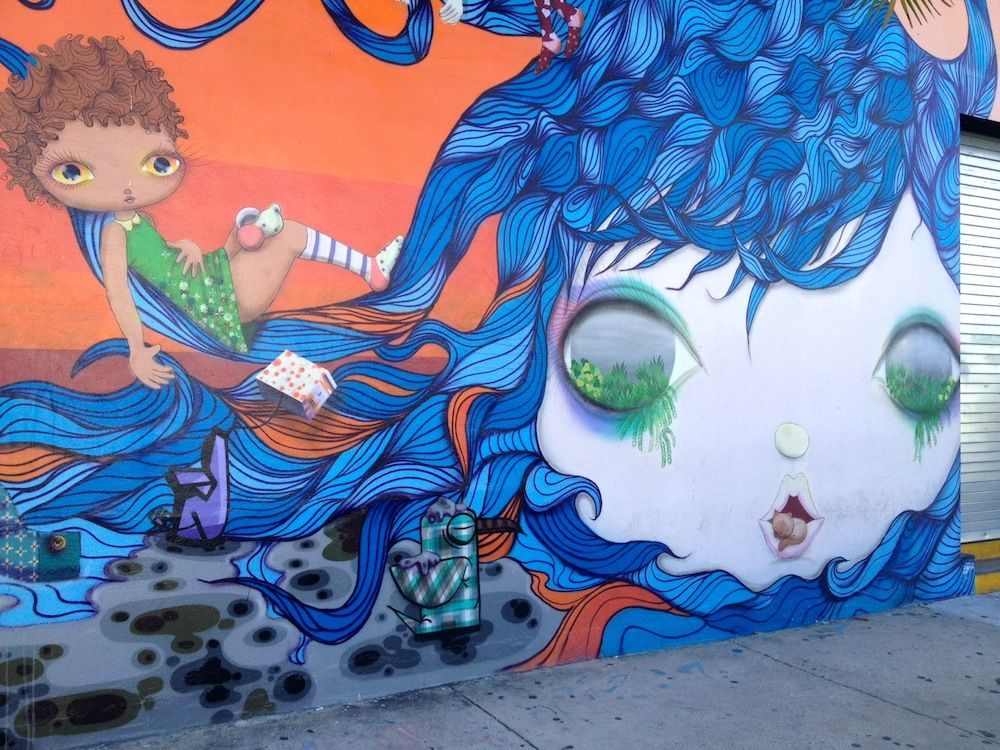 Vibrant. Mural girl riding the waves of flow in Wynwood.
