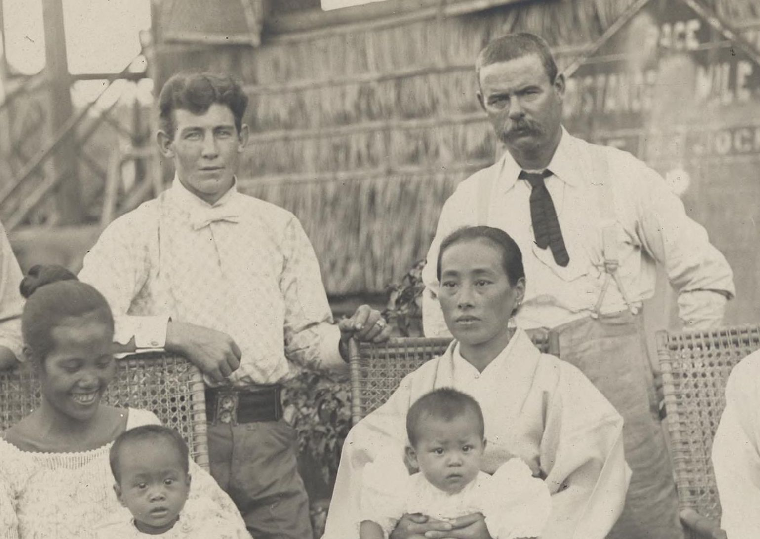 """A close up of a photo labeled: """"Americans, Chinese and Filipinos."""" I've cropped to view the Americans' clothing, which is more humble (soldier on right) and nouveau flash (soldier on left) than the standard white cotton duck suit. Circa 1900-1902."""
