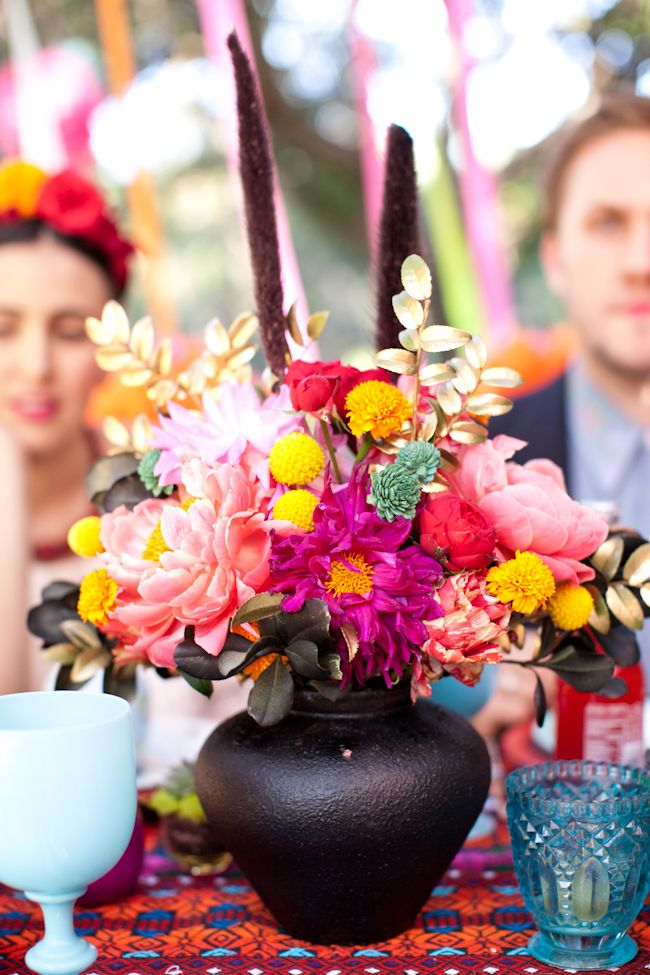 Black Mud Centerpiece Ideal For A Colorfull Mexican Wedding