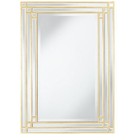 a stylish art large wall mirror with a gold finish and beveled glass