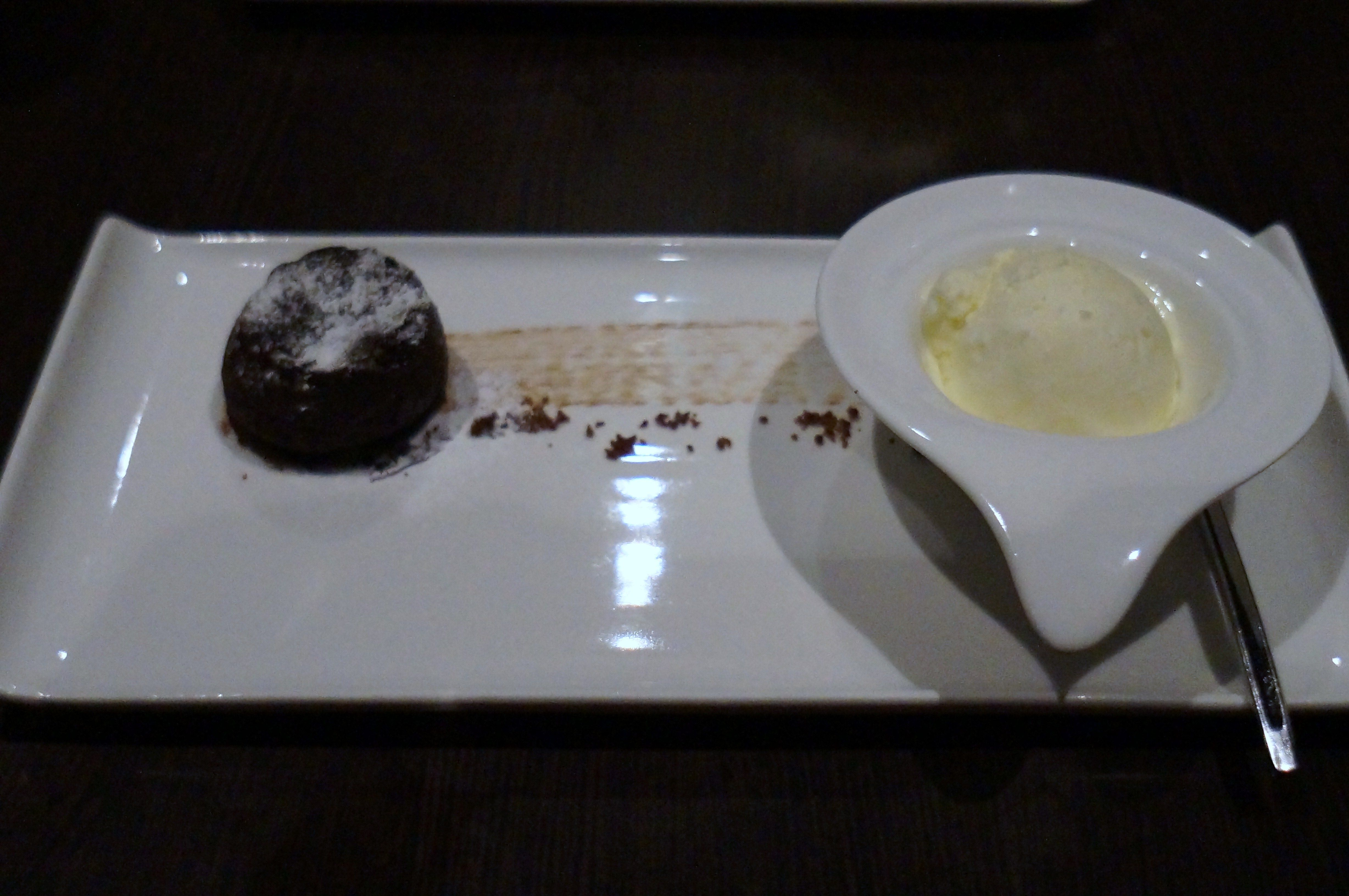 Dozo's freshly baked warm chocolate cake served with vanilla ice cream - http://www.gucciwealth.com/dozos-freshly-baked-warm-chocolate-cake-served-with-vanilla-ice-cream/