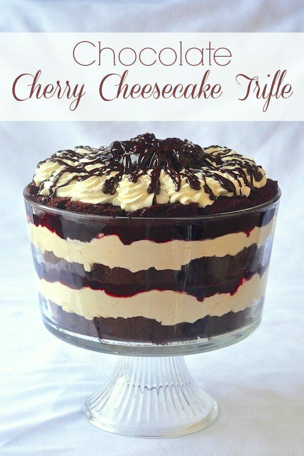 Cheesecake Trifle Chocolate Cherry Cheesecake Trifle - layers of cake, chocolate sauce, cherry compote and cheesecake filling. A real celebration dessert that's terrific for serving large crowds so if you want to forego the pies, this could make a great Thanksgiving dinner dessert!Chocolate Cherry Cheesecake Trifle - layer...