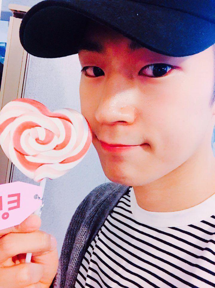 Seungjun with a lollipop