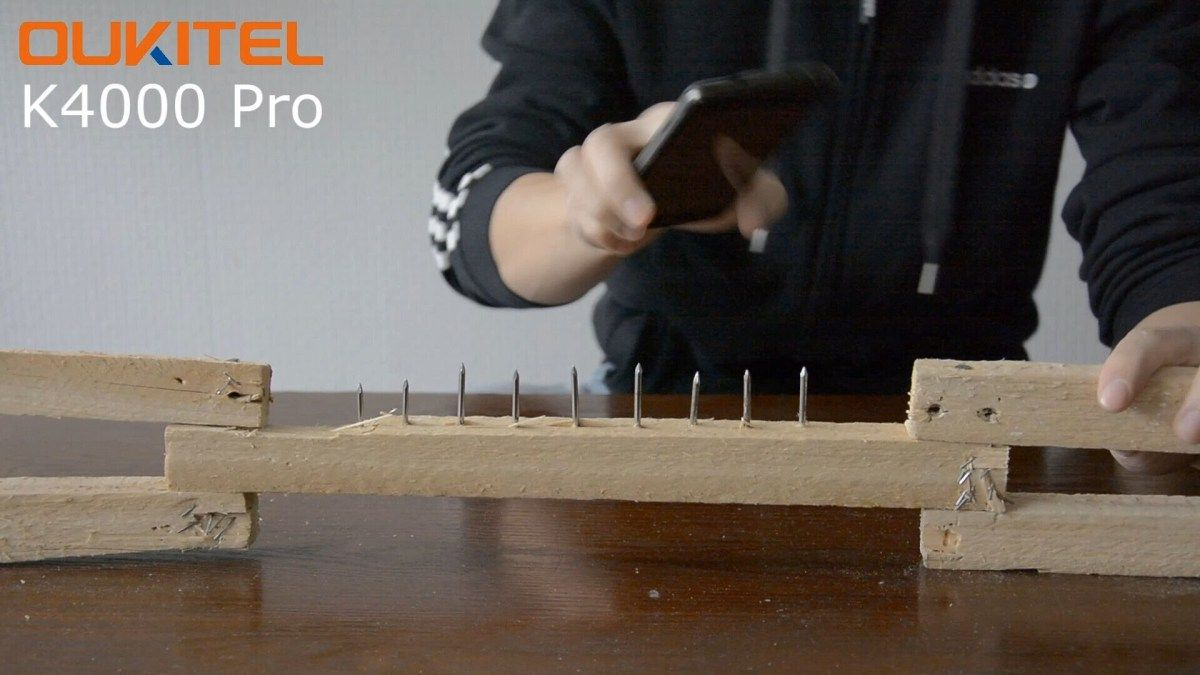 Oukitel are at it again with another test of strength showing off the amount of abuse the 1.1mm thick display of the Oukitel K4000 Pro can take.