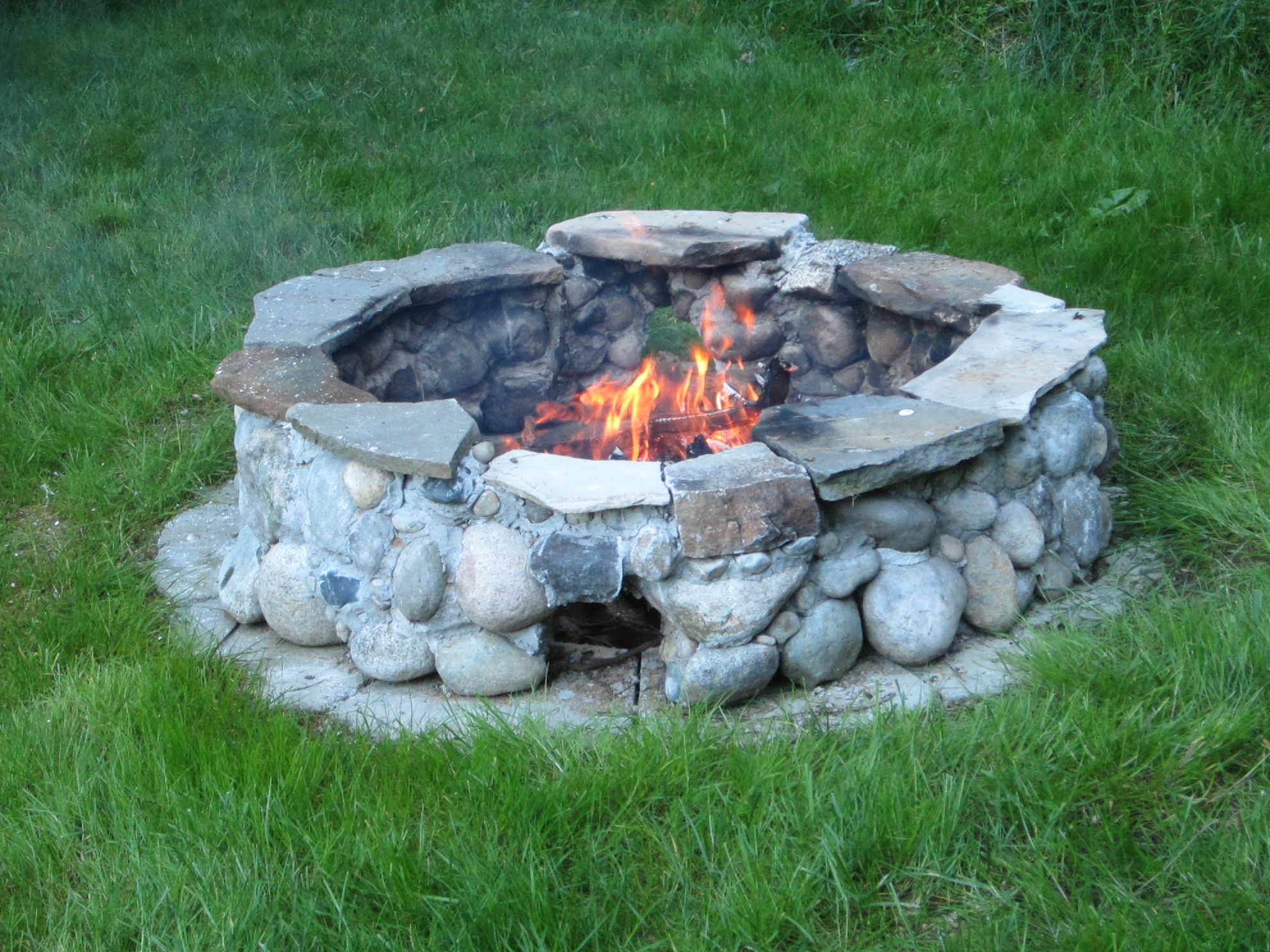 My Newly Built Fire Pit Mortared Native Stones With Four Air Vents Foot Warming Holes Around The Base The Stone Fire Pit Fire Pit Backyard Fire Pit Seating