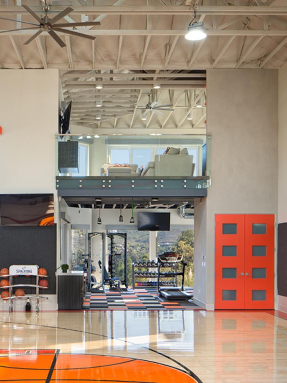 In This Private Basketball Court From Charco Design Build Charcoal Wall Padding And Polished Floors Ma Home Gym Design Home Basketball Court Basketball Room