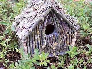 Cover a cheap birdhouse with weathered twigs to give it a more rustic feel.