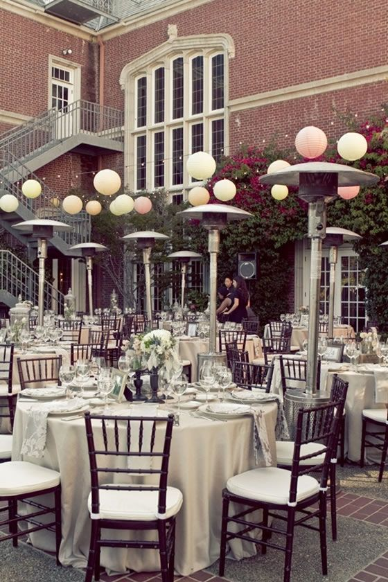 An Outdoor Reception With Neutral Linens Dark Wood