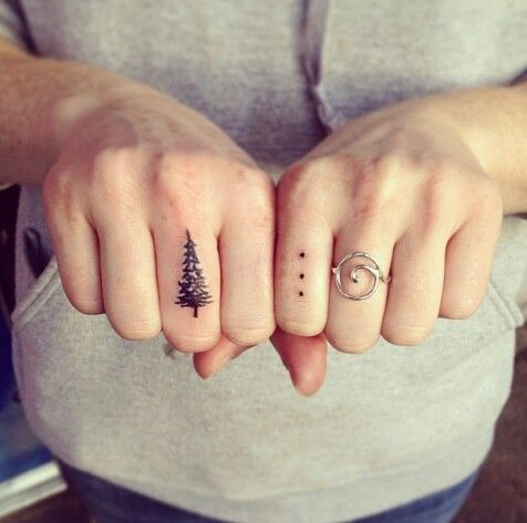 Evergreen finger tattoo.