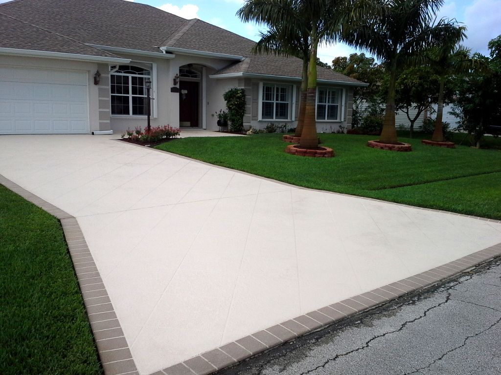 Decorative Concrete Resurfacing Can Match House Color Or It Might Match The Turf Backyard Or Match Concrete Driveways Concrete Patio Concrete Driveway Pavers