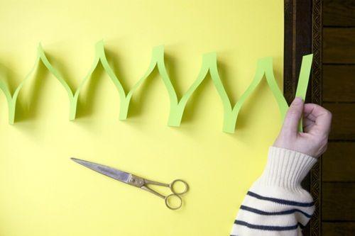 Divertida guirnalda de papel con forma de acordeón