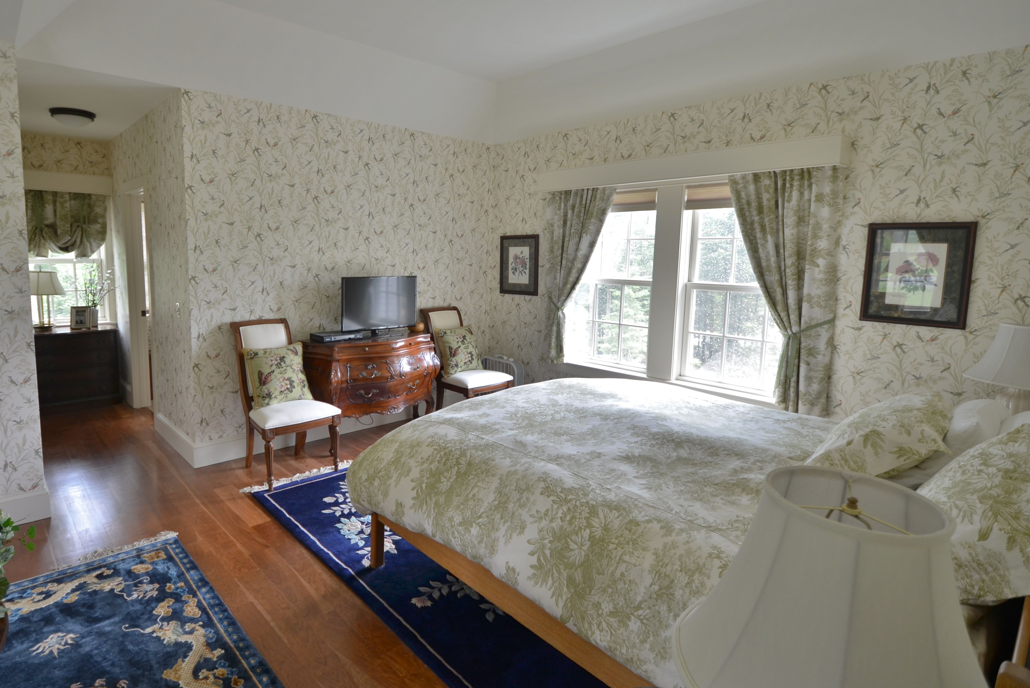 Master bedroom on first floor  The master bedroom suite of this home is located directly off the