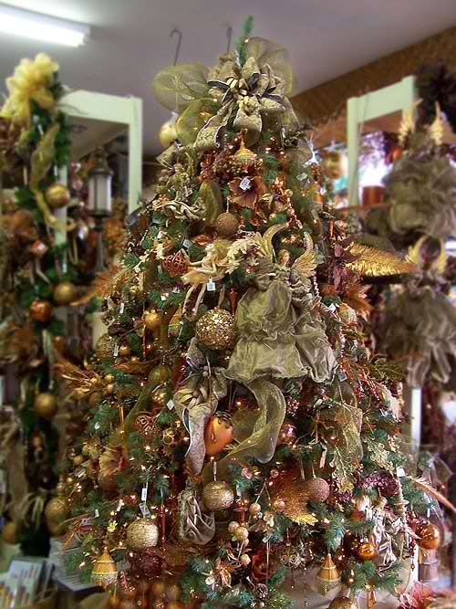 this pre decorated artificial pre lit christmas tree features many glittering tree ornaments that are surrounded with little elves and beautiful angels - Pre Decorated Artificial Christmas Trees