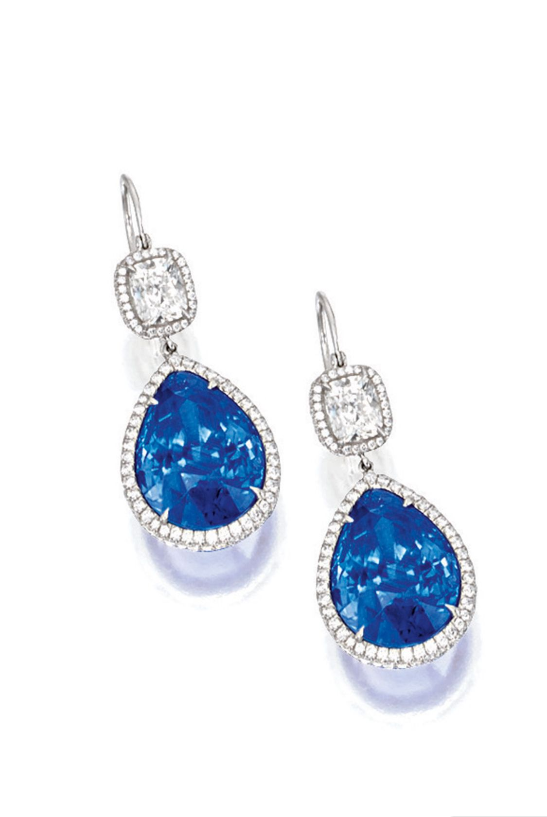 Pear piercing ideas  PAIR OF SAPPHIRE AND DIAMOND PENDENT EARRINGS Each suspending on a