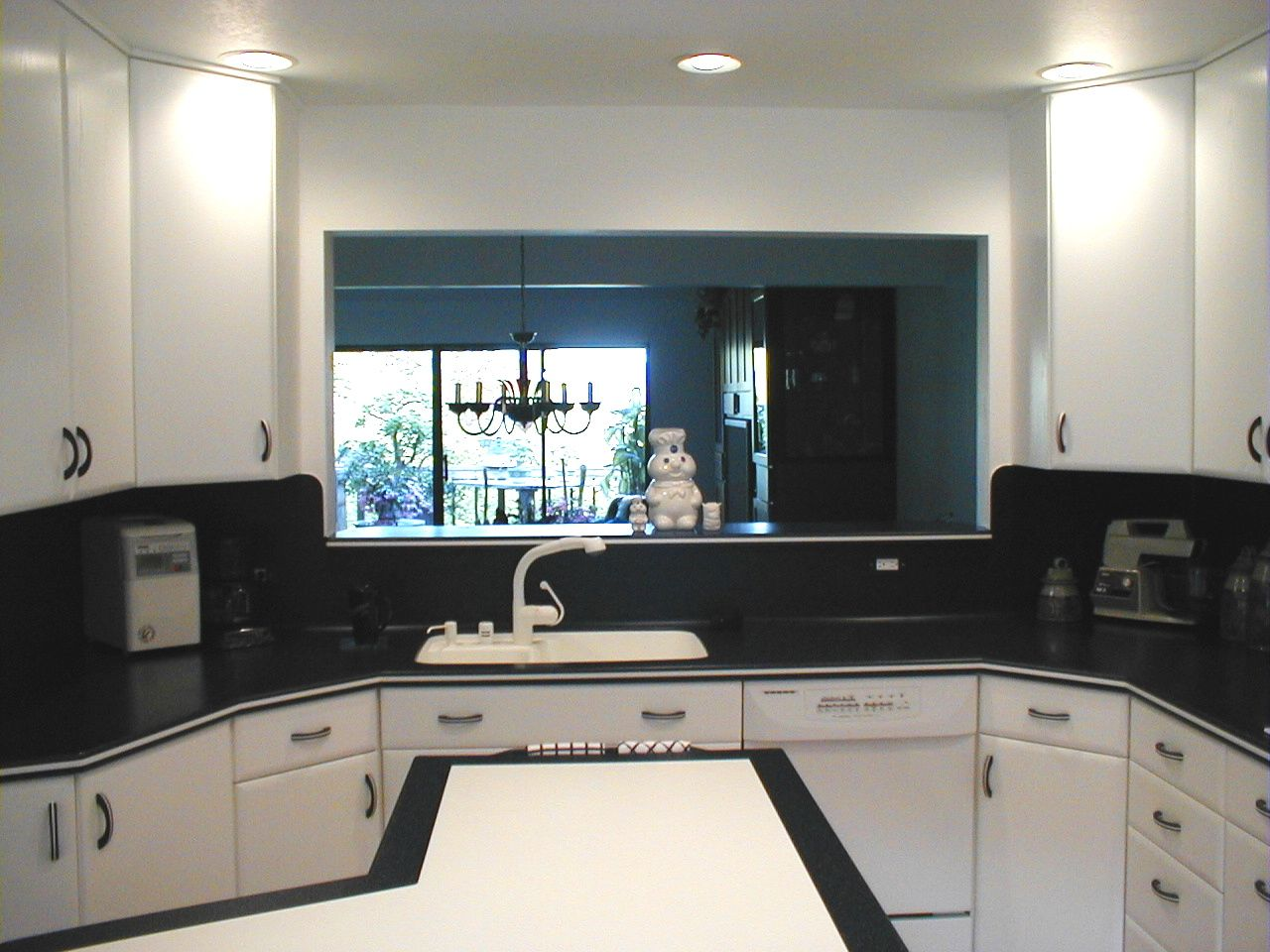 Maybe no cabinets above the stove and pass thru to keep it more open ...