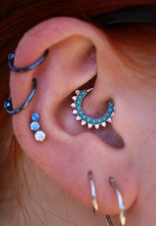 tobiasxvallone:  One of my favorite daith piercings to date. Featuring a beautiful Gem Kolo ring from BVLA with turquoise set in 14k white gold.   Healed piercing by Tobias.