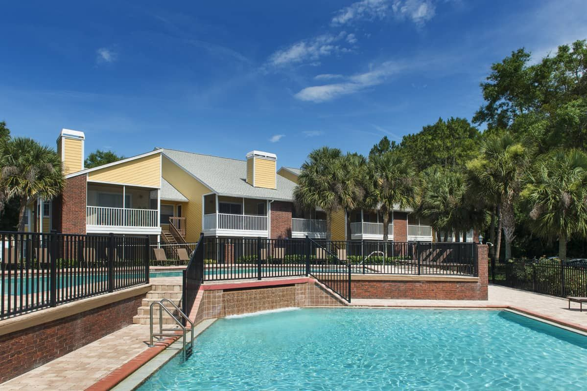 Surrounded By Nature Lotus Landing Is An Enclave Of Charming Two And Three Story Brick Buildings Centered Around A Sun Drench Brick Building Altamonte Springs Building