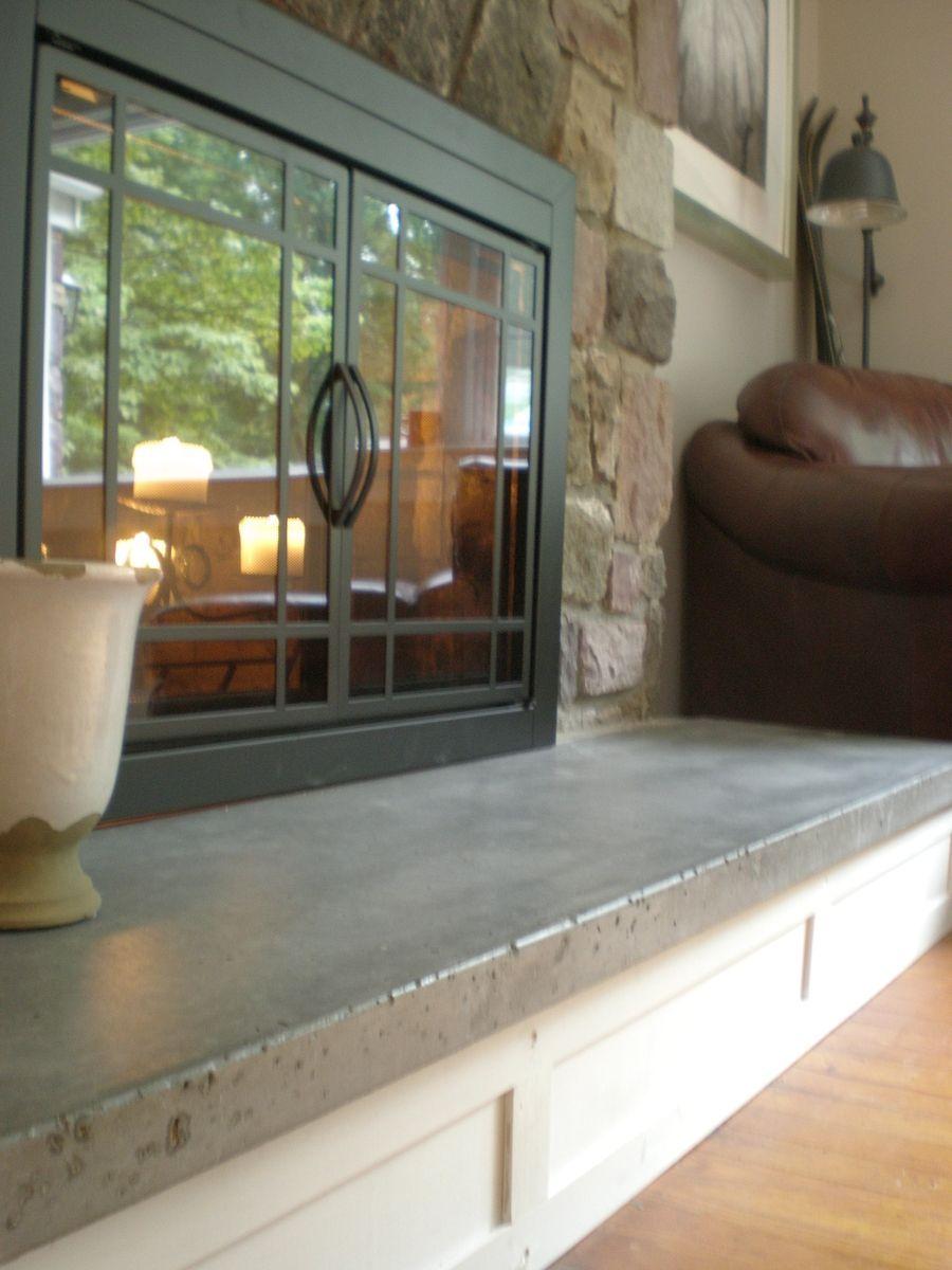 custom made concrete hearth and custom mantel fireplace wall