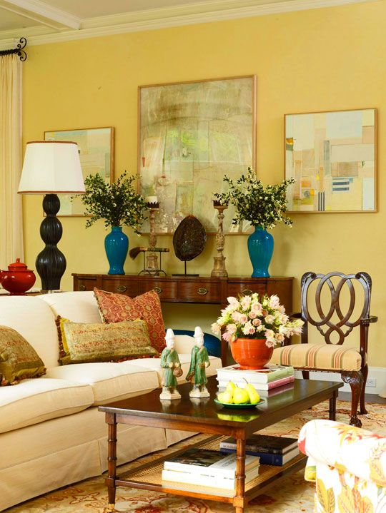Beautiful yellow living room love the symmetry of vases and candlesticks also decorating ideas you  ll rh pinterest
