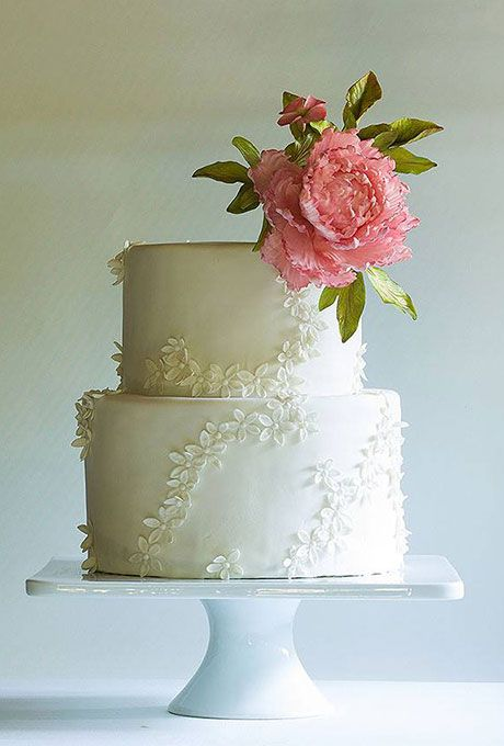 Brides Two Tier Wedding Cake With Lace And Pink Flower Topper To Create