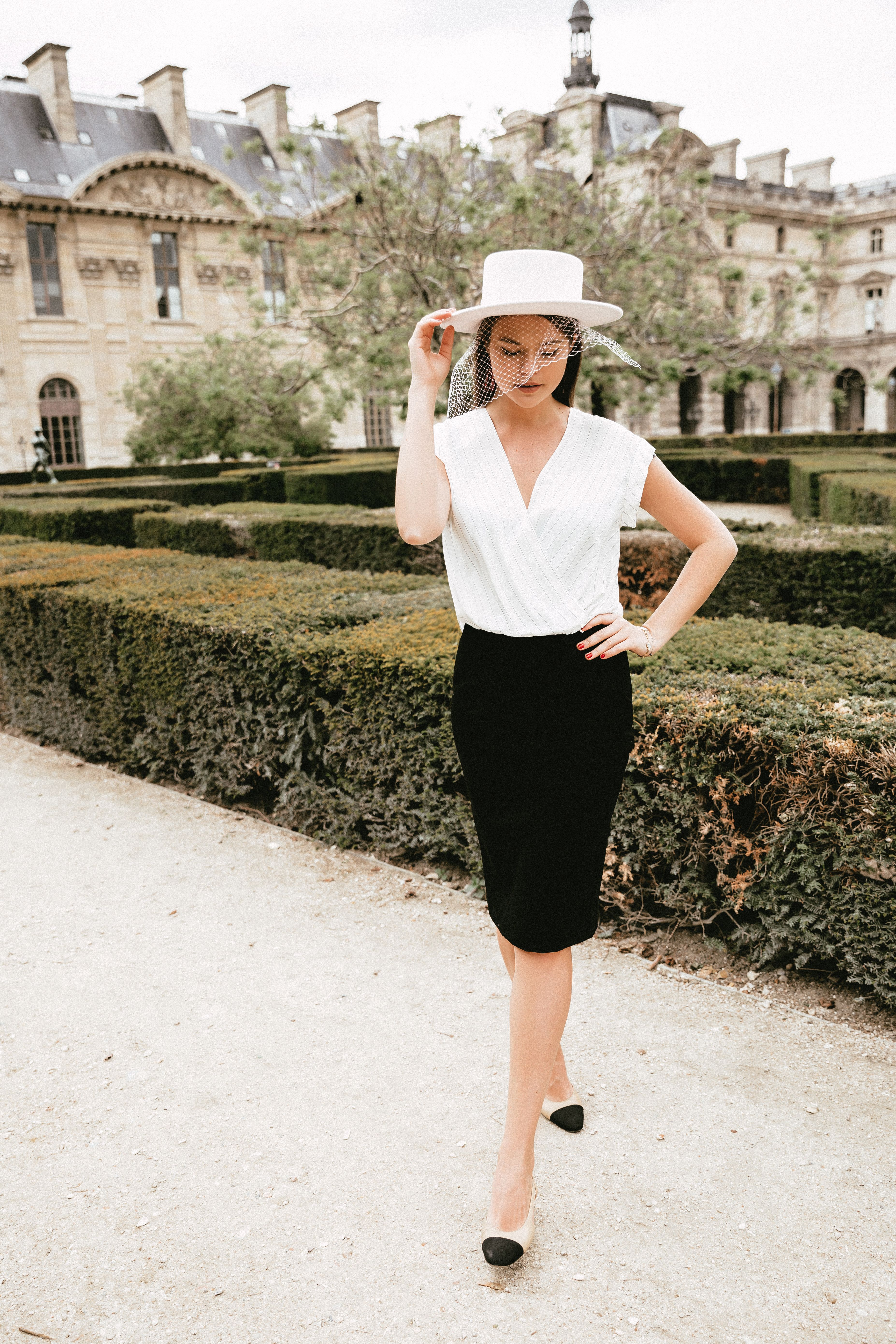 The Elegance Of A White Top And A Black Bottom Is Timeless Now