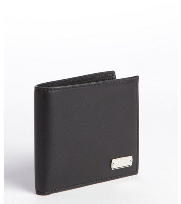 5949cd271354 Gucci black leather engraved logo plate bi-fold wallet on shopstyle.com