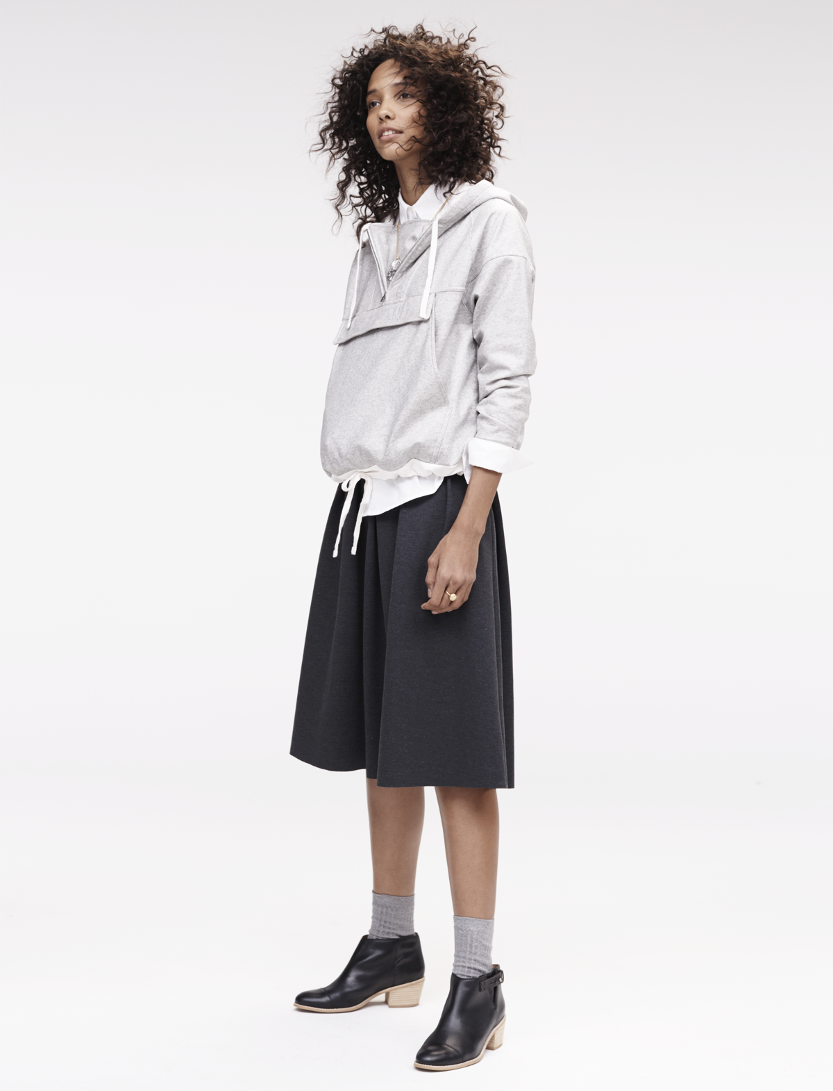 fd2ad9f01a Madewell pleated ponte midi skirt worn with the coated Windwake hoodie