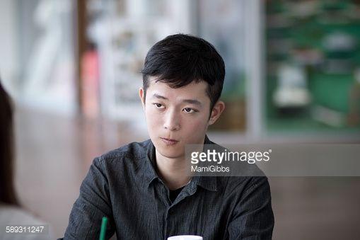 ストックフォト : Young man sitting and hearing the story