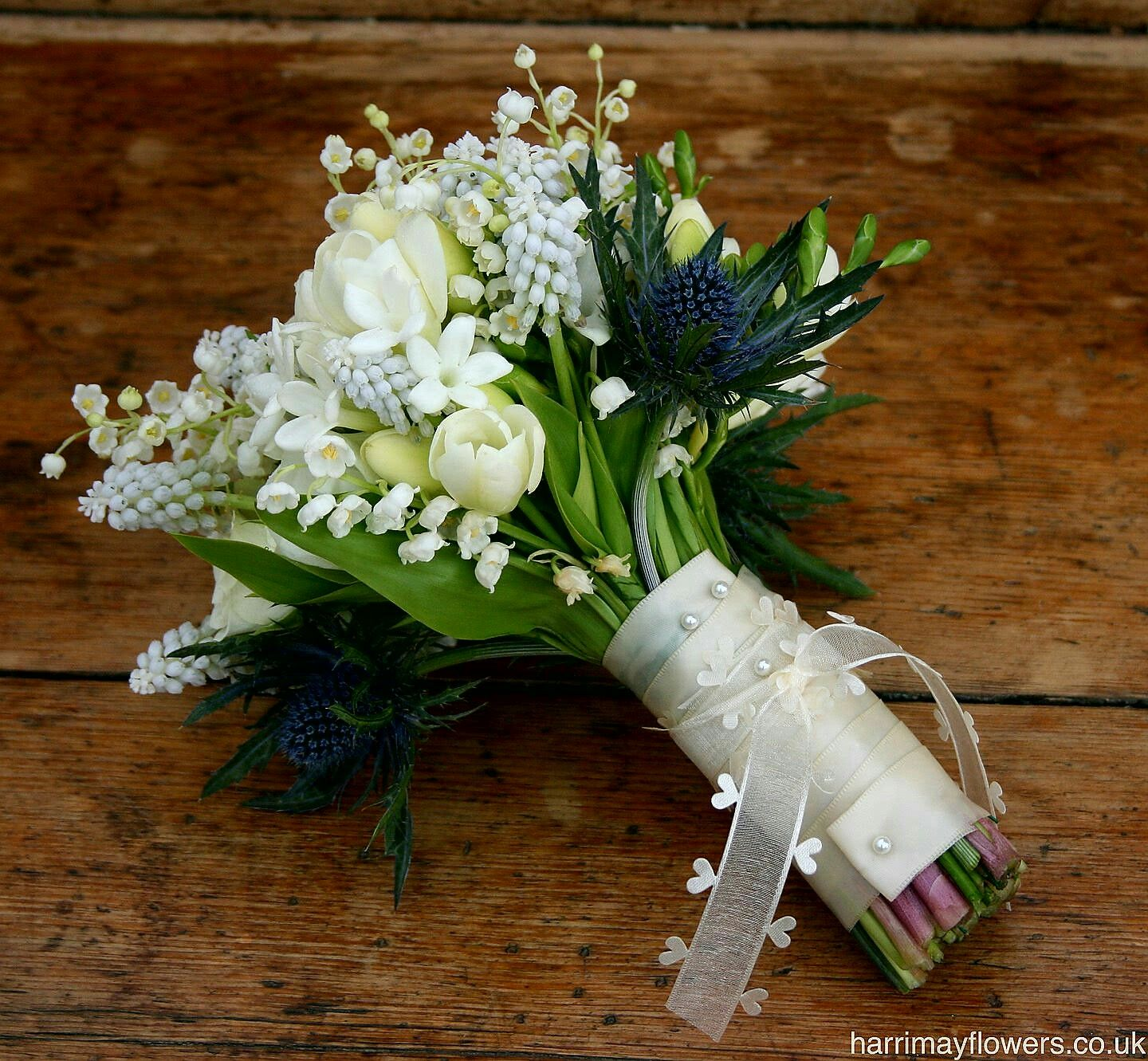 Perfectly sweet hand tied wedding posy which includes blue perfectly sweet hand tied wedding posy which includes blue eryngium thistle lily of the dhlflorist Choice Image