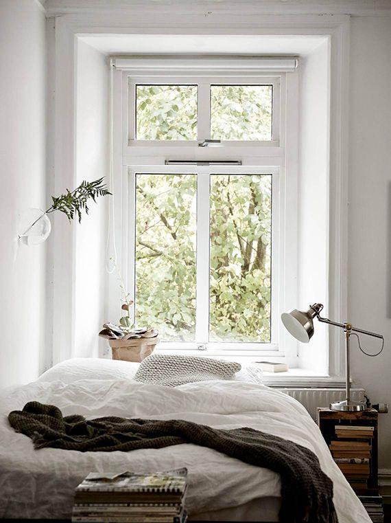 Cozy bed setting | Styling by Emma Fisher, photo by Janne Olander via Stadshem