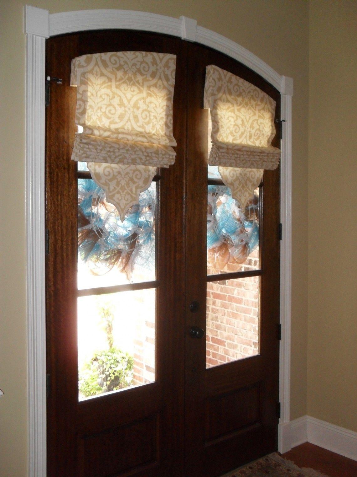 Accessory door with cordless roman shades design for front door