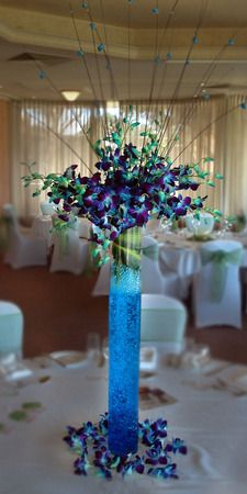 Blue orchids in vase occasions table centerpieces for Midnight blue centerpieces