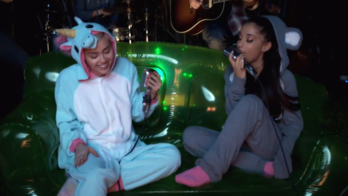 Ariana Grande And Miley Cyrus Singing In Onesies Will Make You