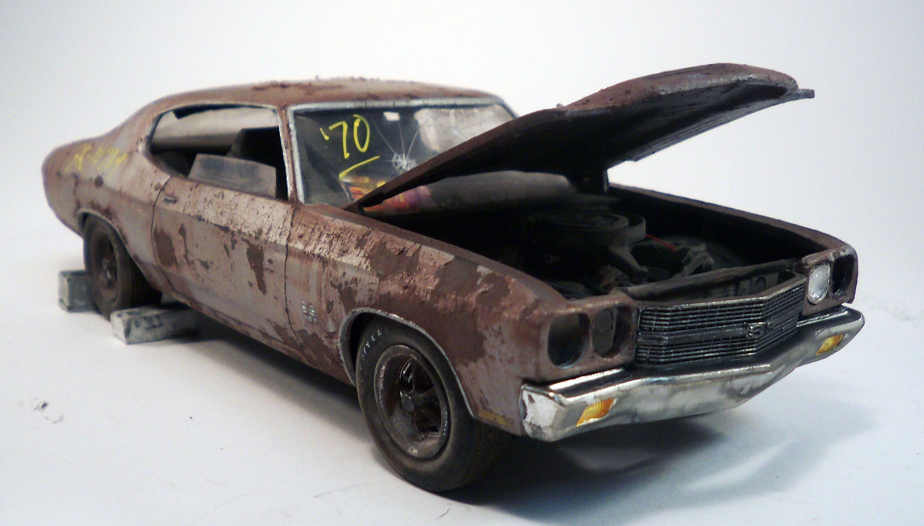 Chevy Chevell model cars. Weathered to the extreme.