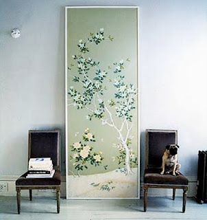 Domino Magazine, framed wallpaper. This large panel of chinoiserie paper used in the dining room Laura Vinroot Poole looks fresh as a backdrop to the modern dining room furnishings.
