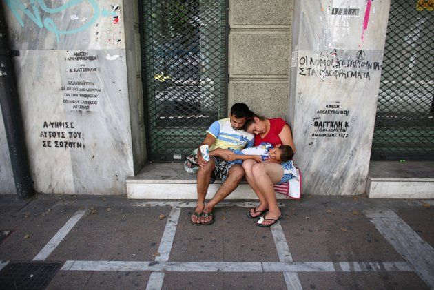 A family beg on the street on June 13, 2012 in Athens, Greece. The Greek electorate are due to go to the polls in a re-run of the general election on June 17, 2012 after no combination of political parties were able to form