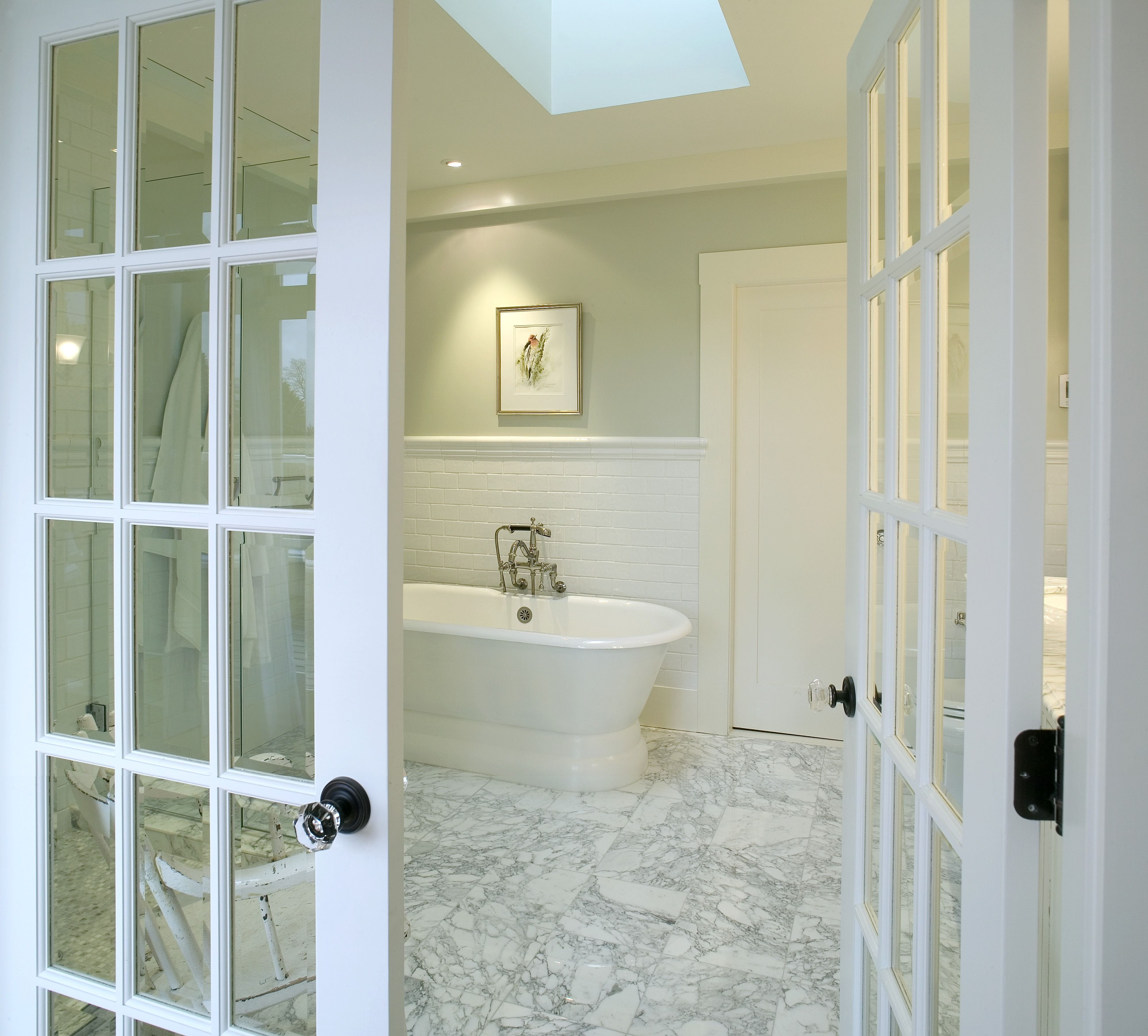 This bathroom is simple and gorgeous! The bath has light green paint ...