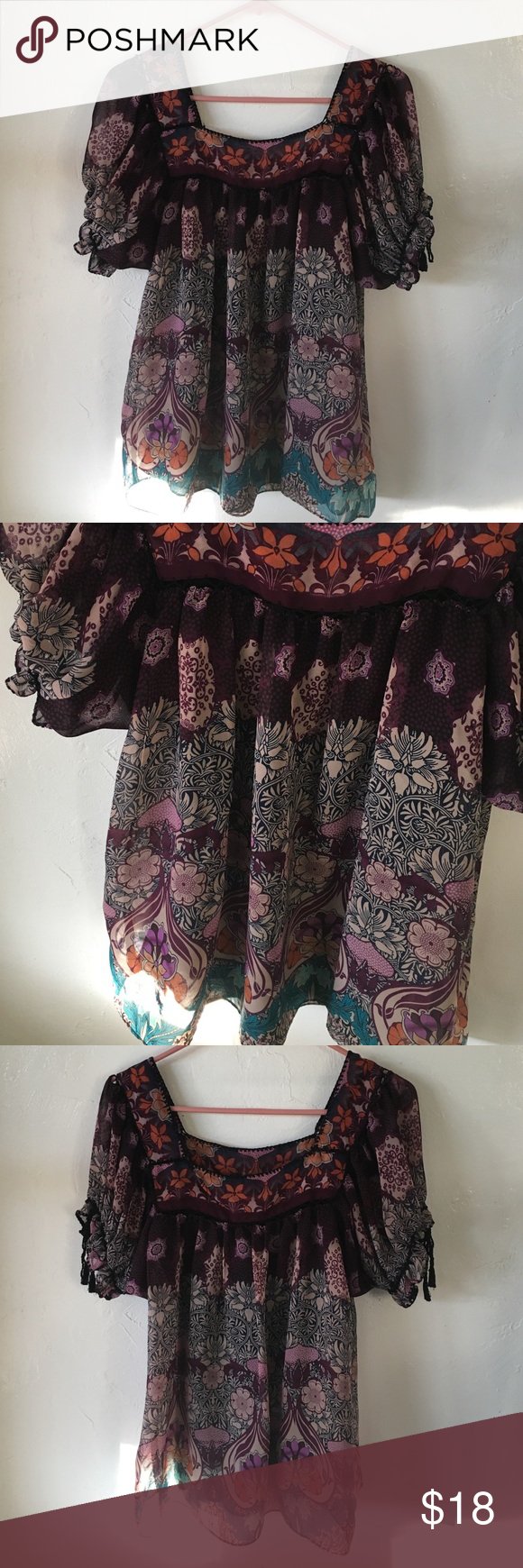 Floral boho blouse This is a fun printed blouse with little cotton thread details around the top. It has ties around each sleeve to make them looser or tighter. This comes with a tank underneath, so not to worry about layering. It is a size 8, but it could fit anyone who wears a small or medium well. It is flowy and awesome colors! I.C.E Tops Blouses