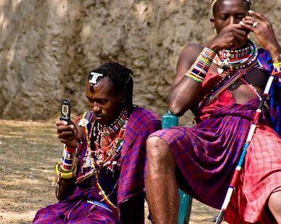Maasai use cell phones in Serengeti