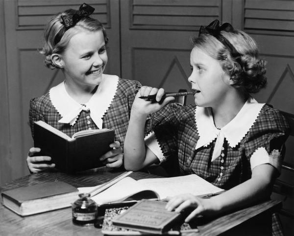 Print of Two girls (10-11) doing homework (B&W)