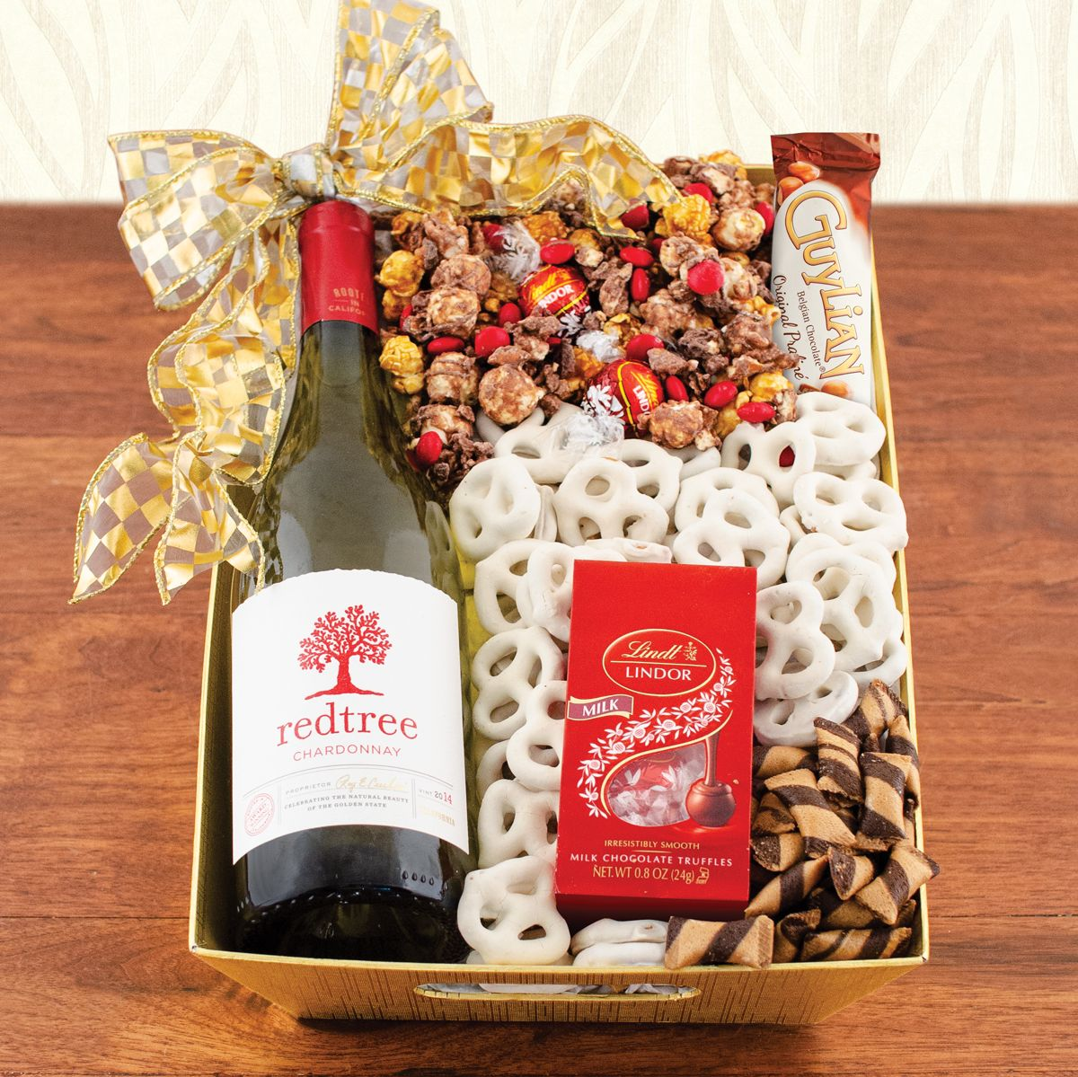 39 99 Pour On The Good Cheer With Redtree Chardonnay And A Festive Mix Of Gourmet Sweets Holiday Wine Gift Red Wine Gifts Red Wine Gift Basket