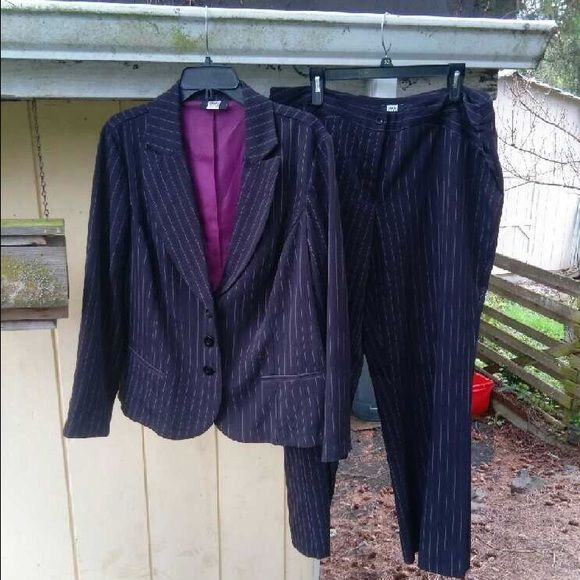 PLUS SIZE SUIT  18w I landed both jobs I applied for in this bad boy. There are threads that have come loose on the pinstripes. Like I said though it's got life in her yet and is still very clean and sharp. I bought this for $100. Suits are not cheap. If you are in need of a great interview suit look no further. Pinstripe pants and jacket. Pants are boot cut. Jacket is satin lined with 3 buttons. I'm 5'11 and the pants were long enough to wear heels. Jacket comes to hip. Questions welcome…