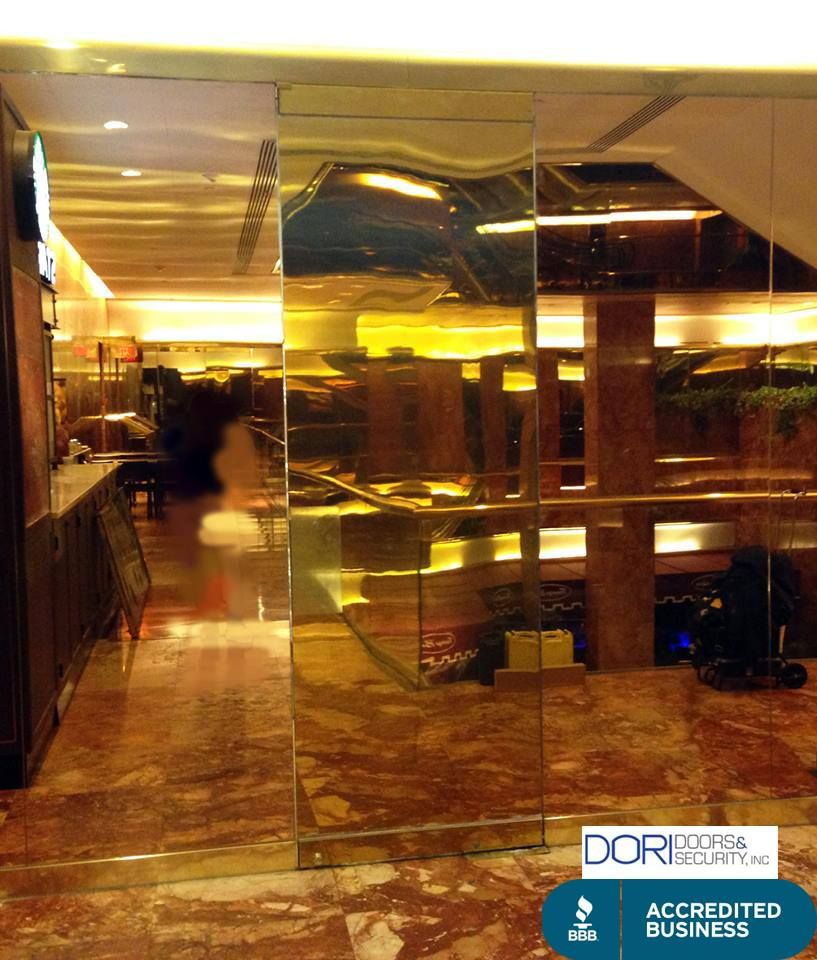 Brass Cladding Door With Mirror Partitions At Trump Tower 5th