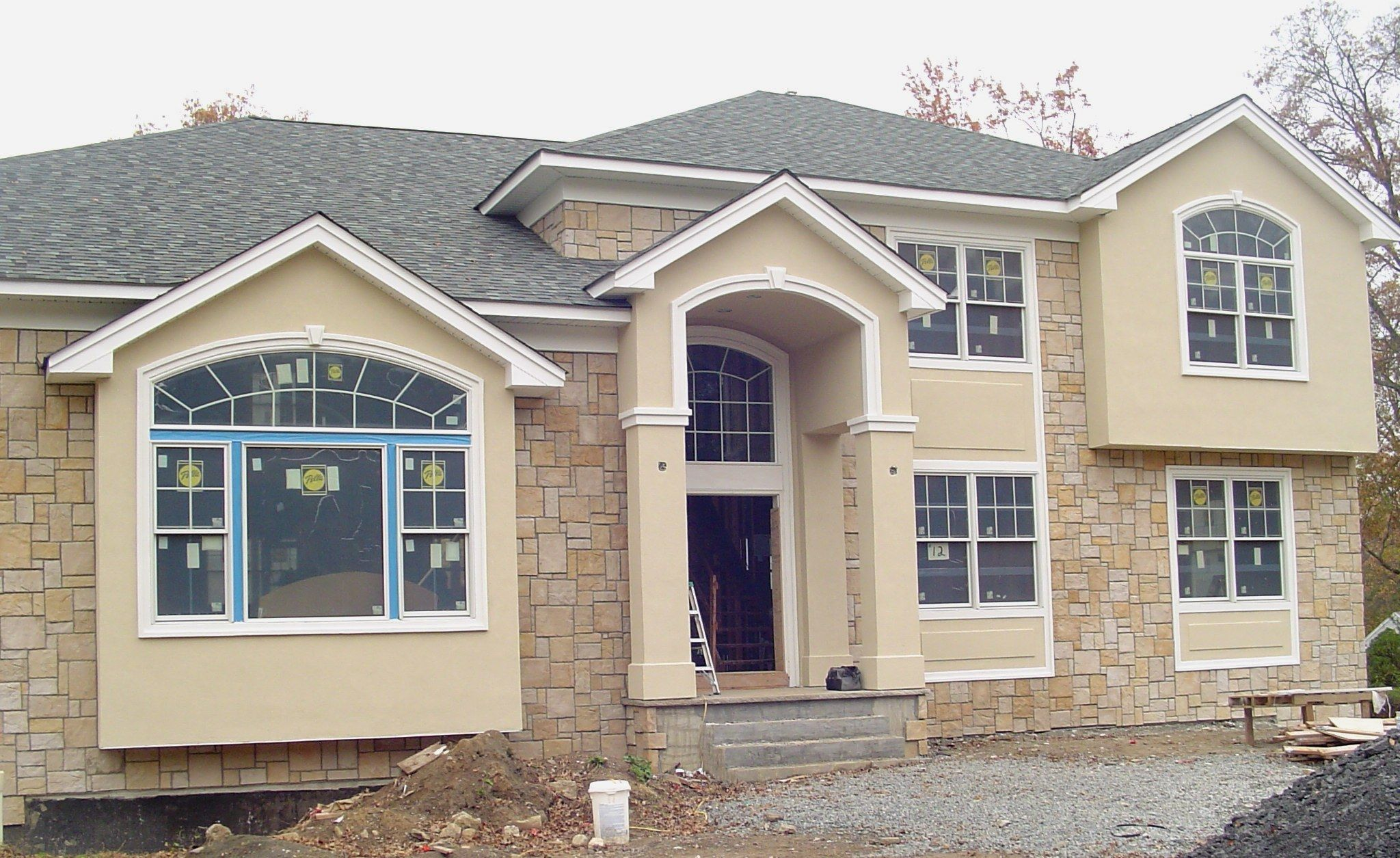 Exterior Stucco Trim dark gray house with white trim stucco trim design ideas pictures