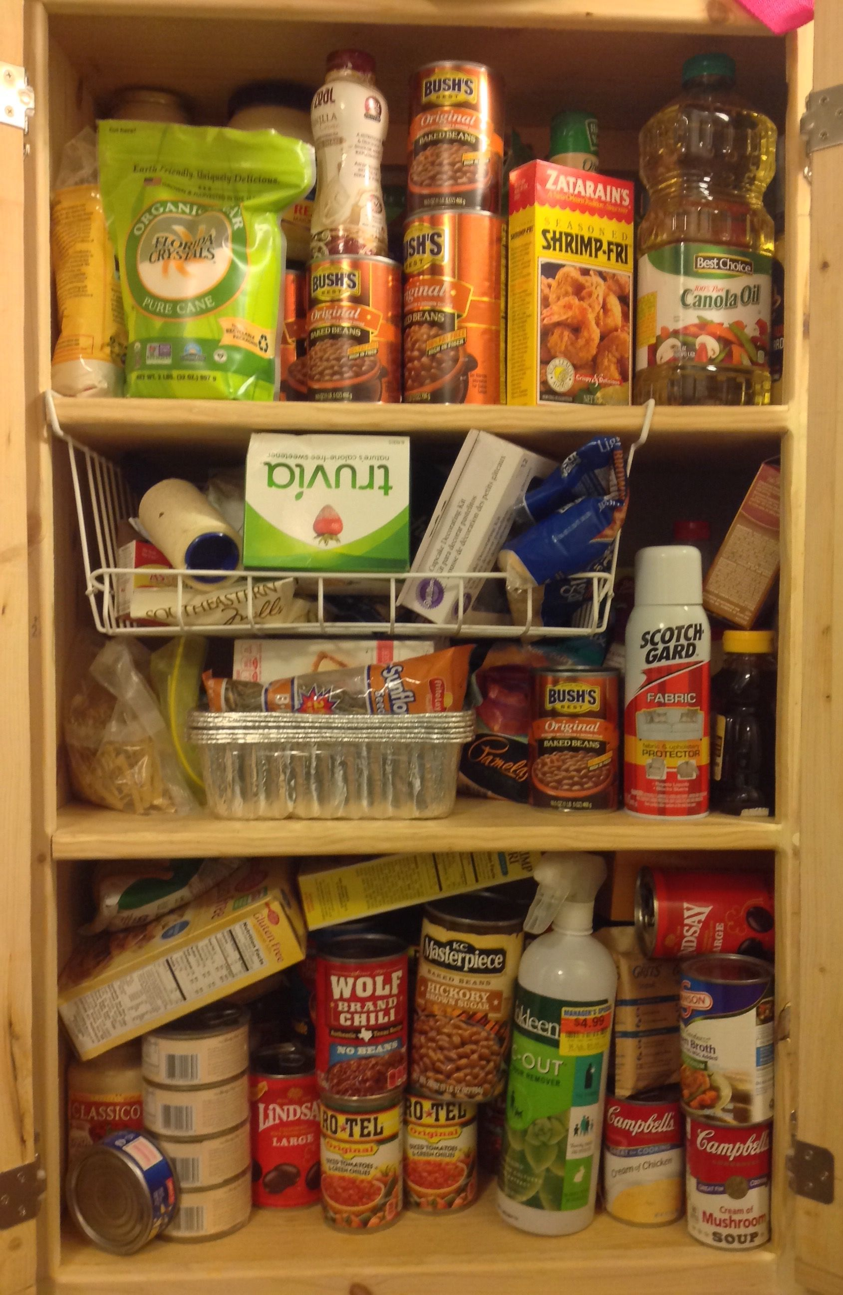 This is part of the hall pantry... we don't have much storage space so everything is jammed in and jumbled up. Watch for the after picture :)