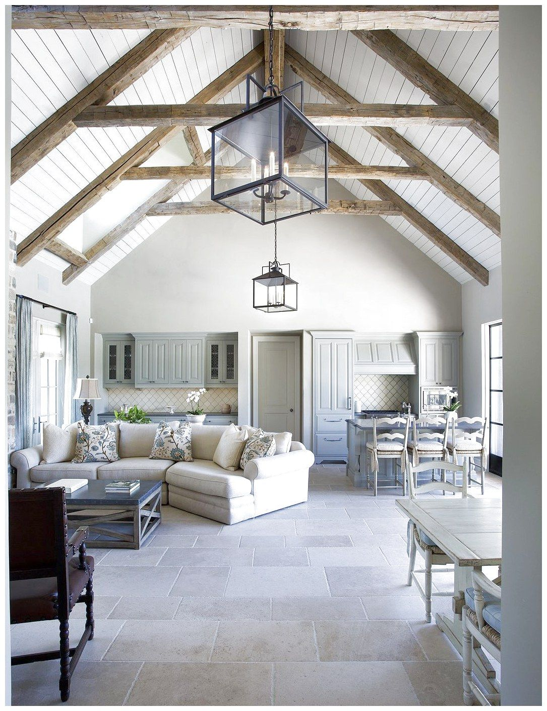 Cathedral ceilings with exposed beams. White washed, bright interior ...