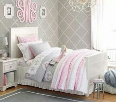 Such a pretty little girls room; quilts, white sheers, monogram.