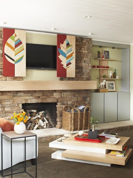A Flat Panel Tv And Diy Leaf Motif Art Panels That Can Hide The Hide The Tv Above The Fir Hide Tv Over Fireplace Contemporary Family Rooms Fireplace Design