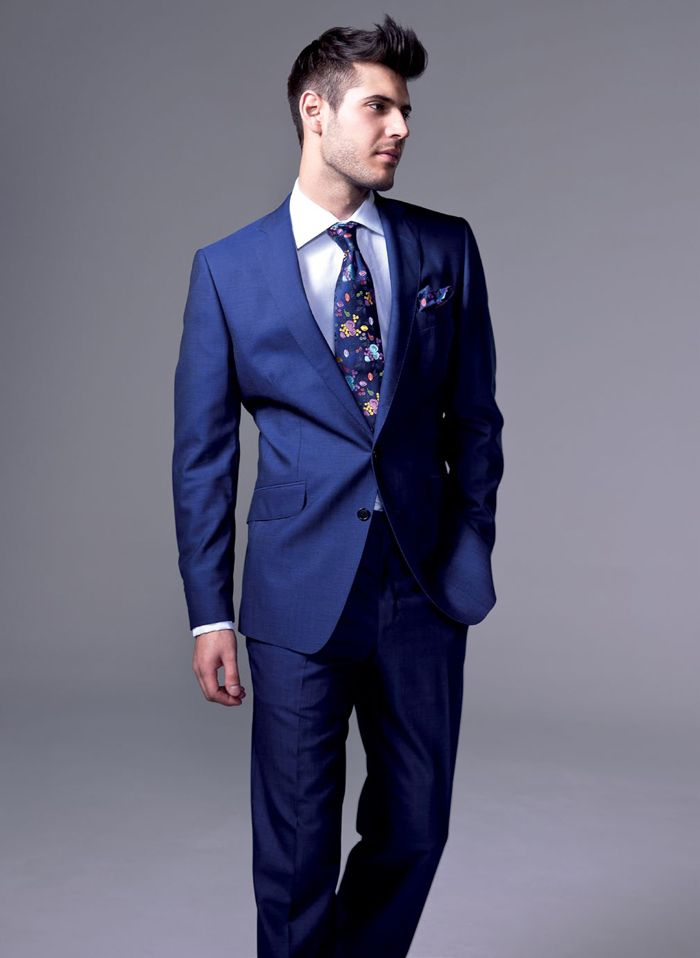 A fancy blue suit paired with some Converse shoes (red or creme ...