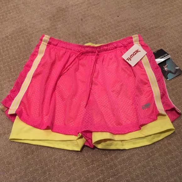 Brand new Marika Running shorts with spandex Marika running shorts in hot pink with yellow spandex underneath. Never worn! Tags still attached! Marika Shorts